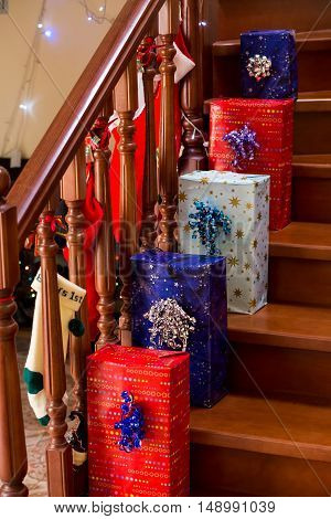 Bright gift boxes on stairs. Christmas presents on decorated staircase. Time to open the presents. Santa left you something.