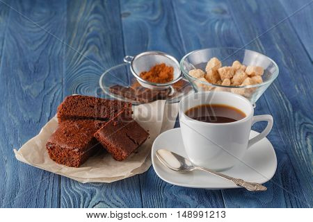 Chocolate Fudge Brownie With Cup Of Espresso Coffee