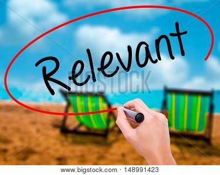 Man Hand Writing Relevant With Black Marker On Visual Screen