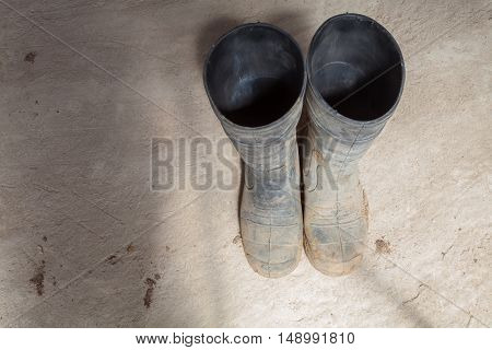Dirty boots of worker during renovation apartment