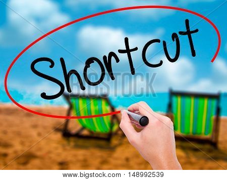 Man Hand Writing Shortcut With Black Marker On Visual Screen