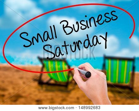 Man Hand Writing Small Business Saturday With Black Marker On Visual Screen