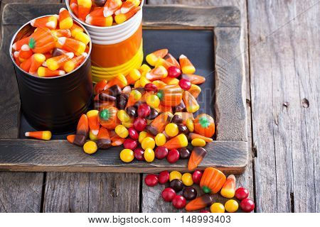 Halloween candy candycorn in two jars copy space