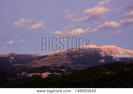 Sunset on Majella mountain and Caramanico village in abruzzo (Italy)