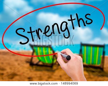 Man Hand Writing Strengths With Black Marker On Visual Screen.