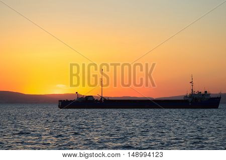 Container ship on the horizon. Beautiful sea landscape