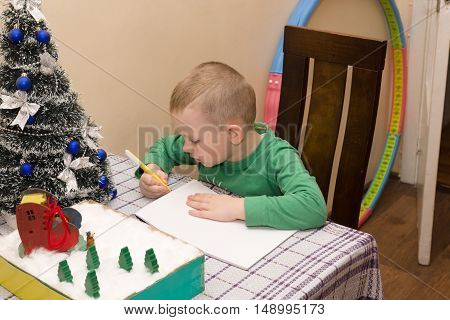 boy writes a letter to Santa Claus who brought him gifts