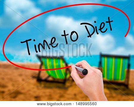 Man Hand Writing Time To Diet With Black Marker On Visual Screen