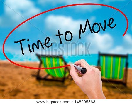Man Hand Writing Time To Move With Black Marker On Visual Screen
