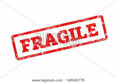 FRAGILE written on red rubber stamp with grunge edges.