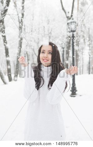 Outdoor Portrait Of Cute Girl White Warm Sweater