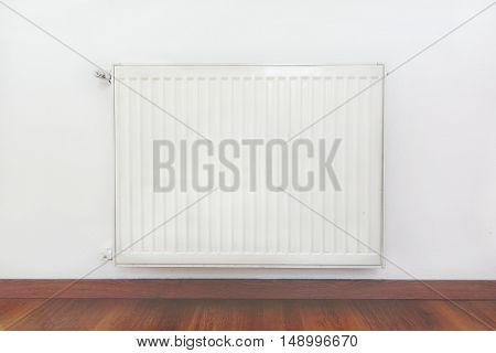 Heating radiator detail against white wall