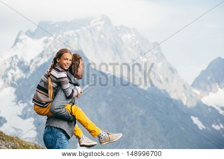 Father with child walking on the mountain, alpine view