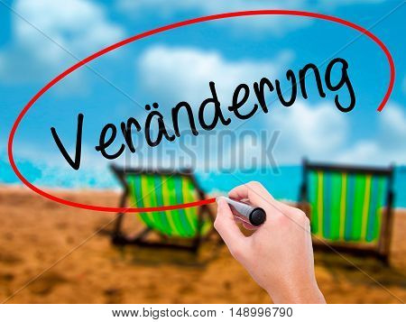Man Hand Writing Ver�¤nderung  (change In German) With Black Marker On Visual Screen
