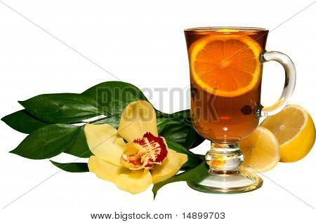 Tsea in a glass, a lemon and flower