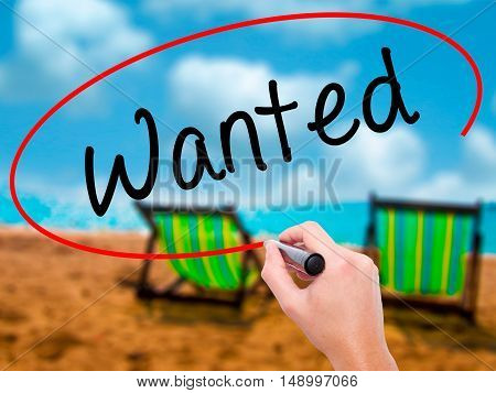 Man Hand Writing Wanted With Black Marker On Visual Screen.