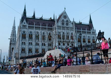 Budapest Hungary - 20 August 2016: Tourists gather near the building of the Parliament before the fireworks during the celebration of St. Stephen's Day.