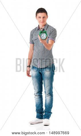 Caucasian young man with alarm clock isolated on white background. Happy boy - full length portrait.