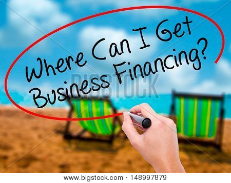 Man Hand Writing Where Can I Get Business Financing? With Black Marker On Visual Screen.