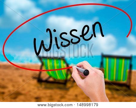Man Hand Writing Wissen (know In German)  With Black Marker On Visual Screen