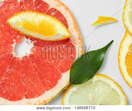 Background of citrus fruit slices, with lemons, oranges and grapefruit