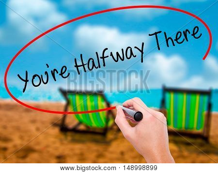 Man Hand Writing You're Halfway There With Black Marker On Visual Screen