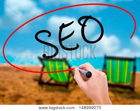Man Hand Writing Seo With Marker On Transparent Wipe Board