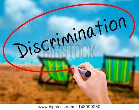 Man Hand Writing Discrimination With Black Marker On Visual Screen