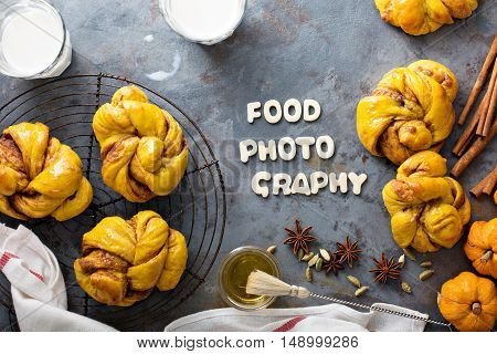 Food photography concept homemade pumpkin cinnamon yeasted buns shot from above