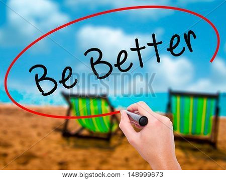 Man Hand Writing Be Better With Black Marker On Visual Screen