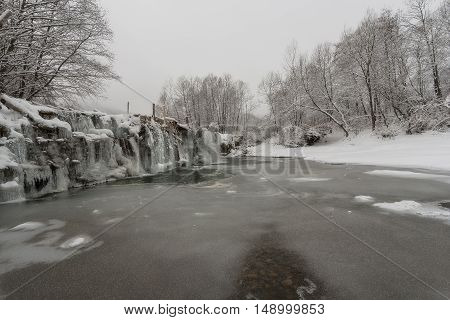 Winter Waterfalls in the Carpathian Mountains. River and rocks covered with snow