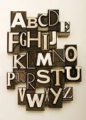 Alphabet photographed using a mix of vintage letterpress characters. Cross-processed for a vintage l