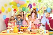 Childrens funny birthday party in decorated room poster