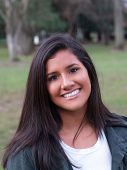 Young Hispanic Teen Outdoor Portrait Big Smile poster