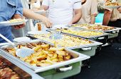 image of catering service  - people choosing food from table on catering and buffet party on business seminar conference or wedding - JPG
