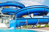picture of summer fun  - happy child have fun on water slike on outdoor swimming pool - JPG