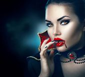Постер, плакат: Vampire Halloween Woman portrait Beauty Sexy Vampire Girl with dripping blood on her mouth Vampire