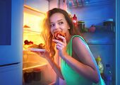 Portrait Of Beautiful Teenage girl Taking Food From Refrigerator at night. Night eating, overeat con poster
