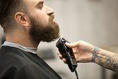 Professional Beard Grooming At Barbershop poster