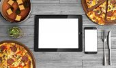 Concept Of Online Food Ordering, Food Delivery, The Food Is Close To The Tablet And Phone On A Woode poster