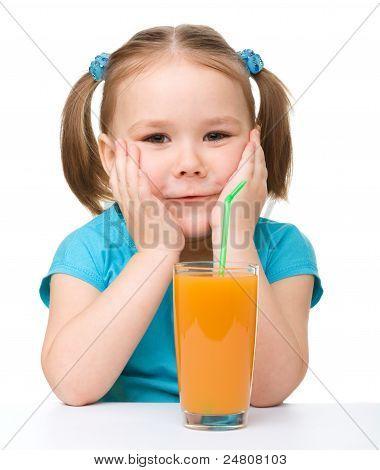 Little Girl Drinks Orange Juice