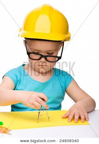 Little Girl Is Playing While Wearing Hard Hat