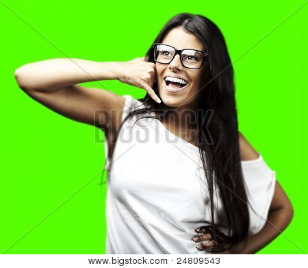 portrait of young woman talking gesture against a removable chroma key background