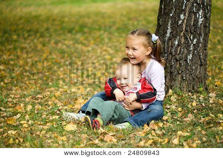 Children Are Playing In Autumn Park