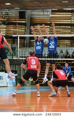 KAPOSVAR, HUNGARY - OCTOBER 29: Jozsef Nagy (blue 3) in action at a Hungarian National Championship volleyball game Kaposvar (blue) vs. Szolnok (red), October 29, 2011 in Kaposvar, Hungary.