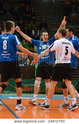 KAPOSVAR, HUNGARY - OCTOBER 29: Kaposvar players celebrate at a Hungarian National Championship volleyball game Kaposvar (blue) vs. Szolnok (red), October 29, 2011 in Kaposvar, Hungary.