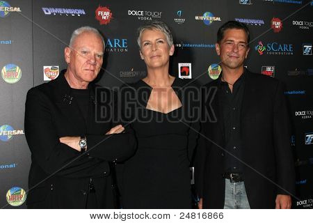 LOS ANGELES - OCT 30:  Malcolm McDowell, Jamie Lee Curtis, Malek Akkad arrives at the sCare Foundation Halloween Launch Benefit at Conga Room - LA Live on October 30, 2011 in Los Angeles, CA