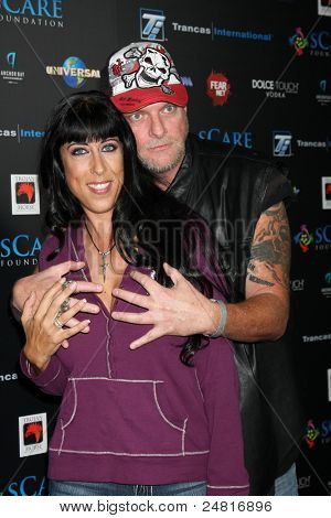 LOS ANGELES - OCT 30:  Brett Wagner, Dee Dee BIgelow arrives at the sCare Foundation Halloween Launch Benefit at Conga Room - LA Live on October 30, 2011 in Los Angeles, CA