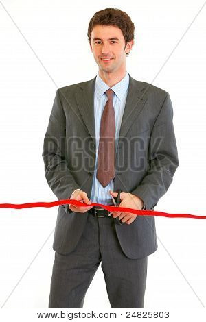 Smiling Modern Businessman Cutting Red Ribbon