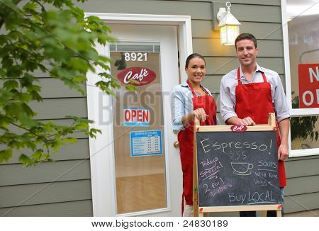 Cafe owners in front of shop